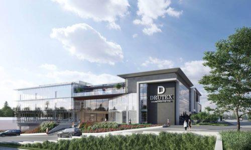 DRUTEX inwestuje wbiurowiec